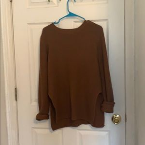 Rusty orange knit sweater with slits